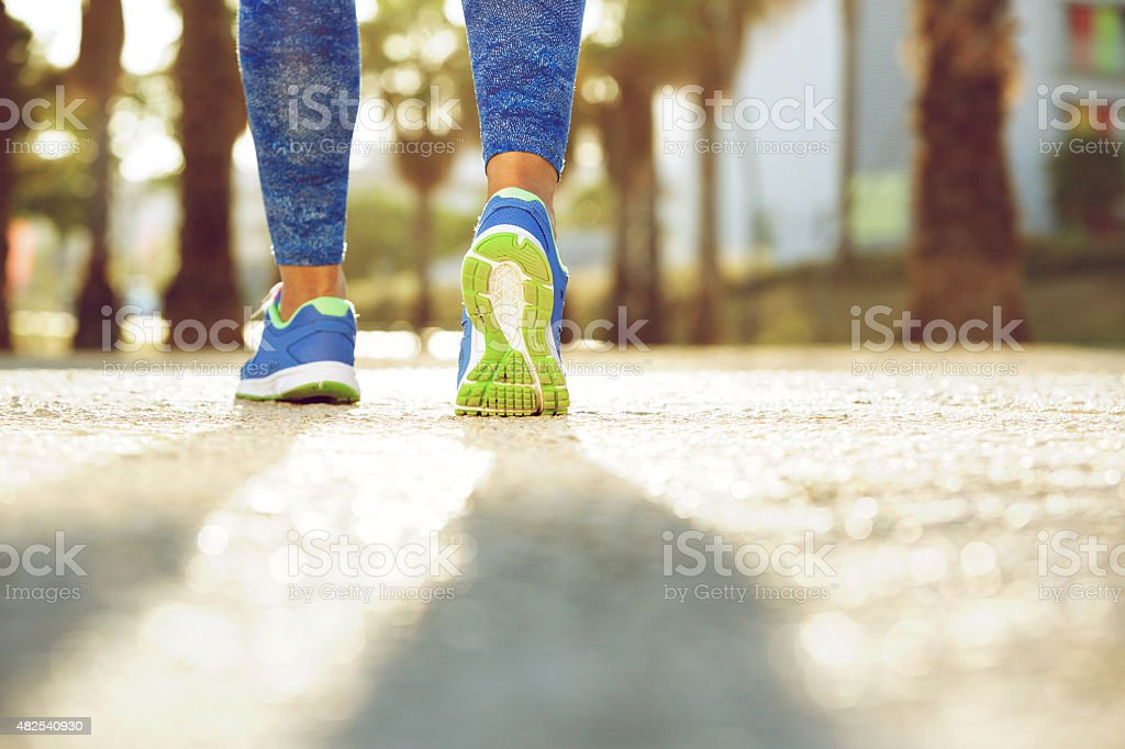Female running shoes from behind stock photo