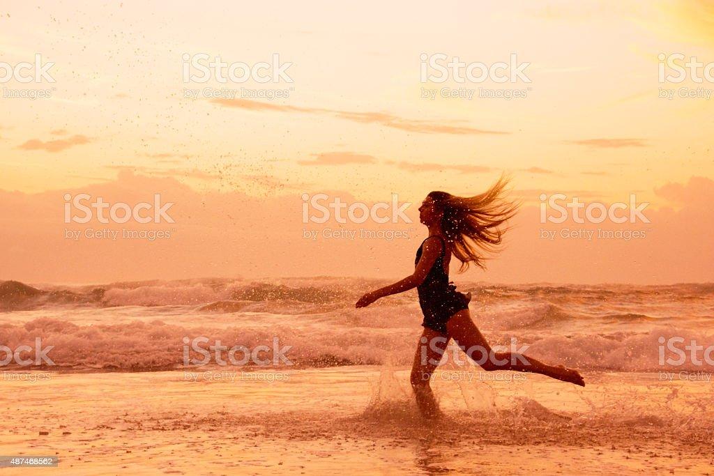 Female running through water stock photo