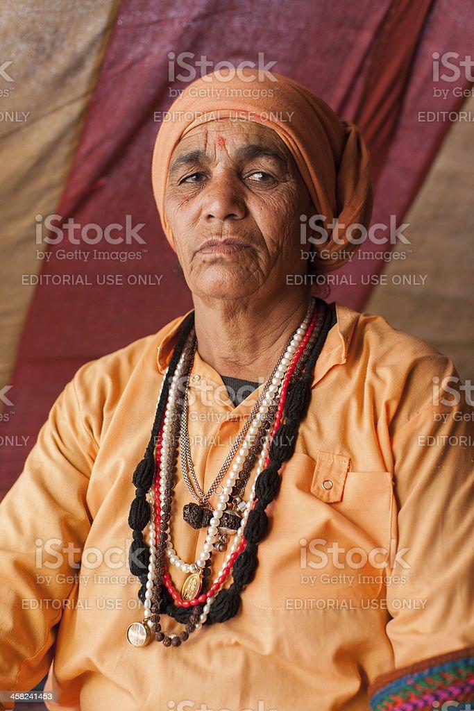 Female sadhu in shelter camp at Kumbh Mela royalty-free stock photo