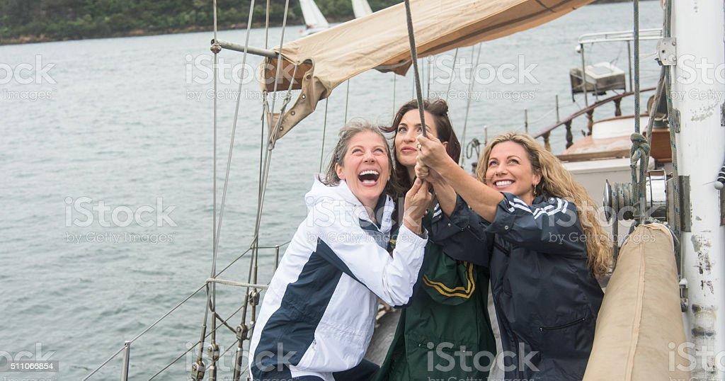 Female sailing crew teamwork Sydney harbour stock photo