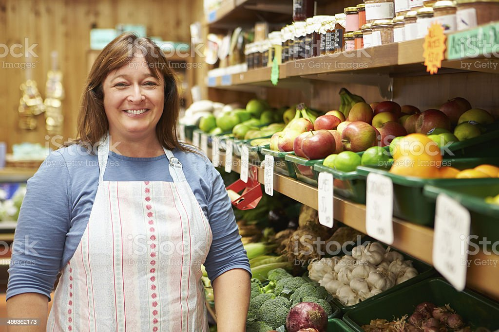 Female Sales Assistant At Vegetable Counter Of Farm Shop stock photo