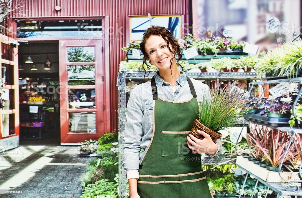 Female sales clerk outdoors stock photo