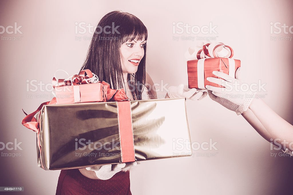 Female Santa Accepting a Christmas Gifts stock photo