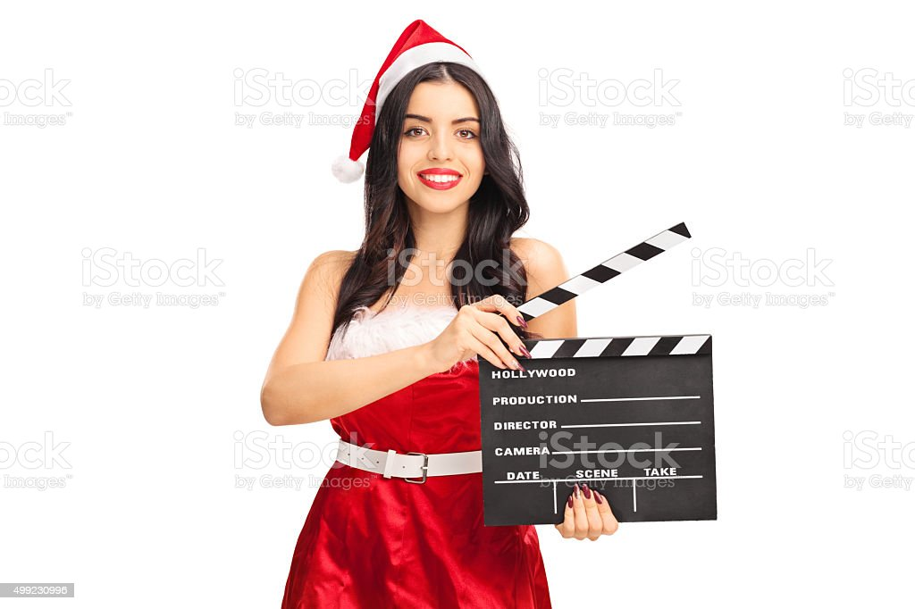 Female Santa holding a movie clapperboard stock photo