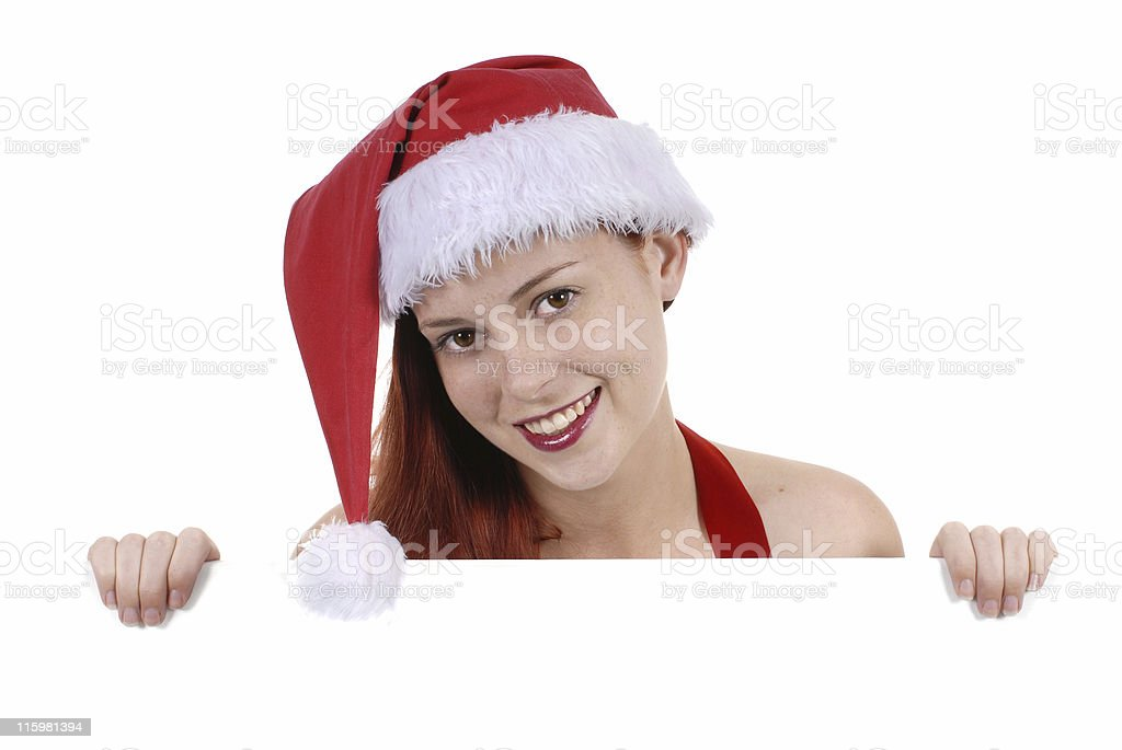 Female santa peeping over a white board royalty-free stock photo