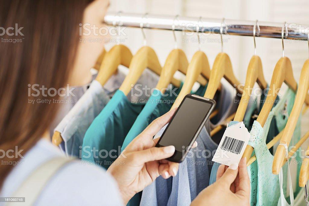 Female Scanning Price Tag Through Smart Phone stock photo