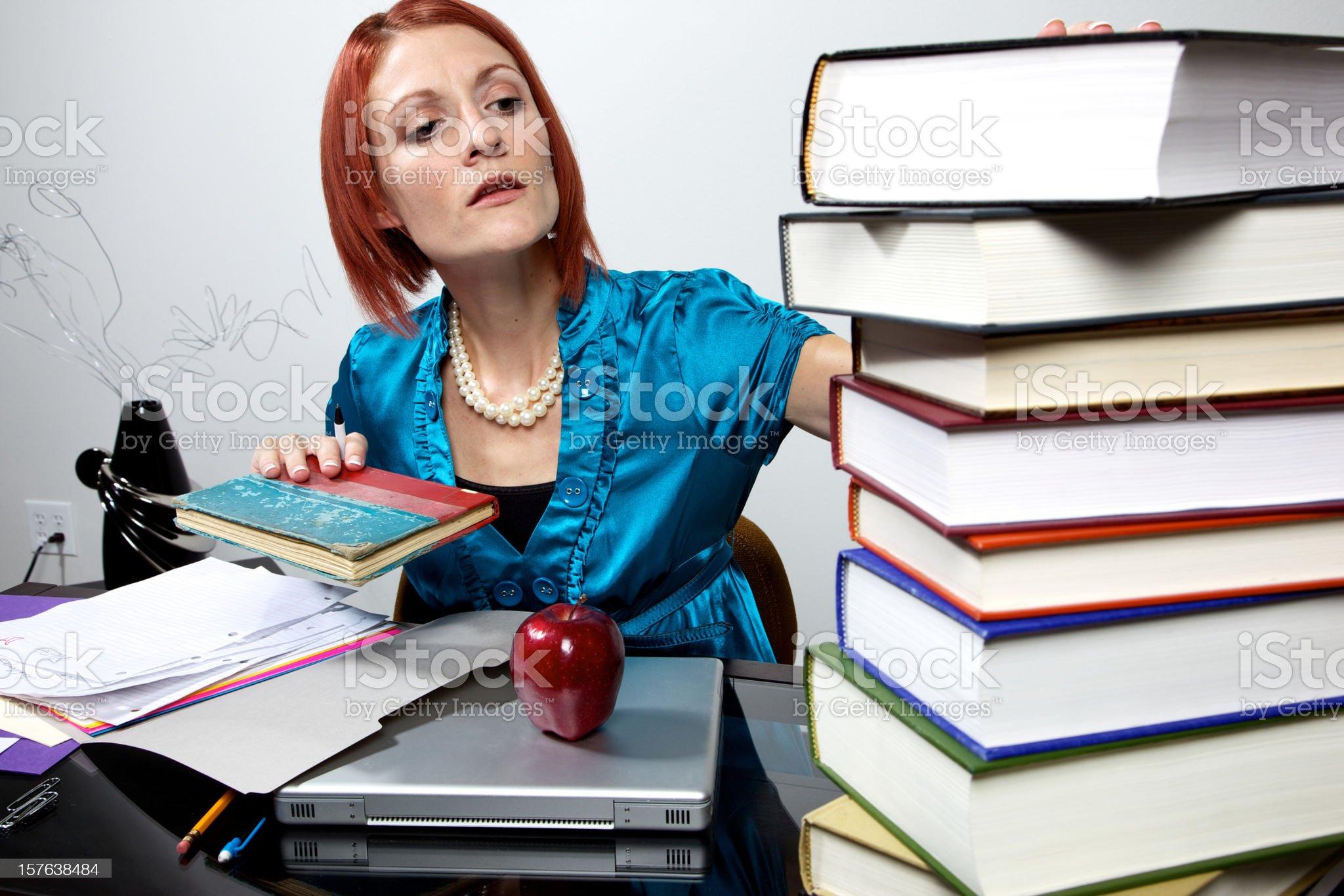 female school teacher grading papers royalty-free stock photo