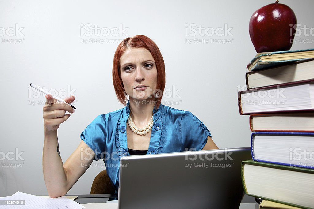 female school teacher grading papers royalty-free stock photo
