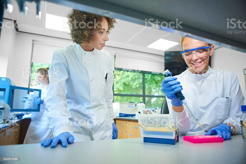 female science lecturer in genetics lab stock photo