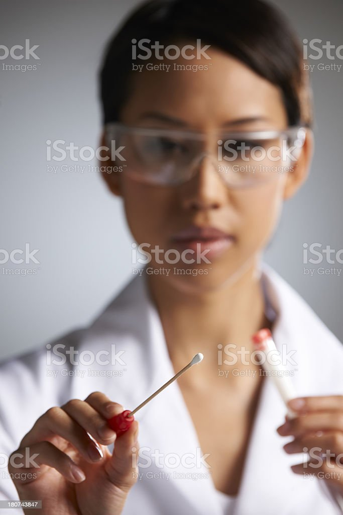 Female Scientist Collecting DNA Sample On Swab stock photo