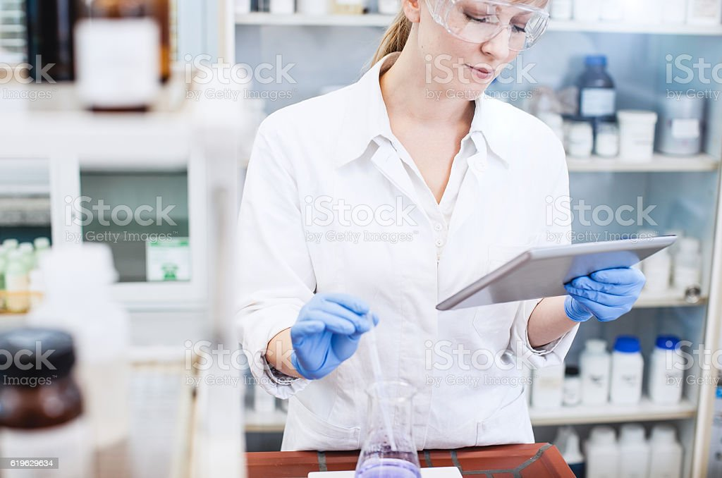 Female Scientist Conducting an Experiment stock photo