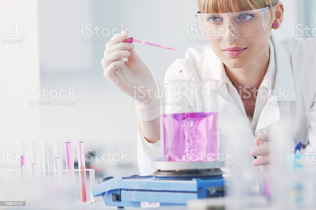 Female scientist doing experiments in a lab royalty-free stock photo