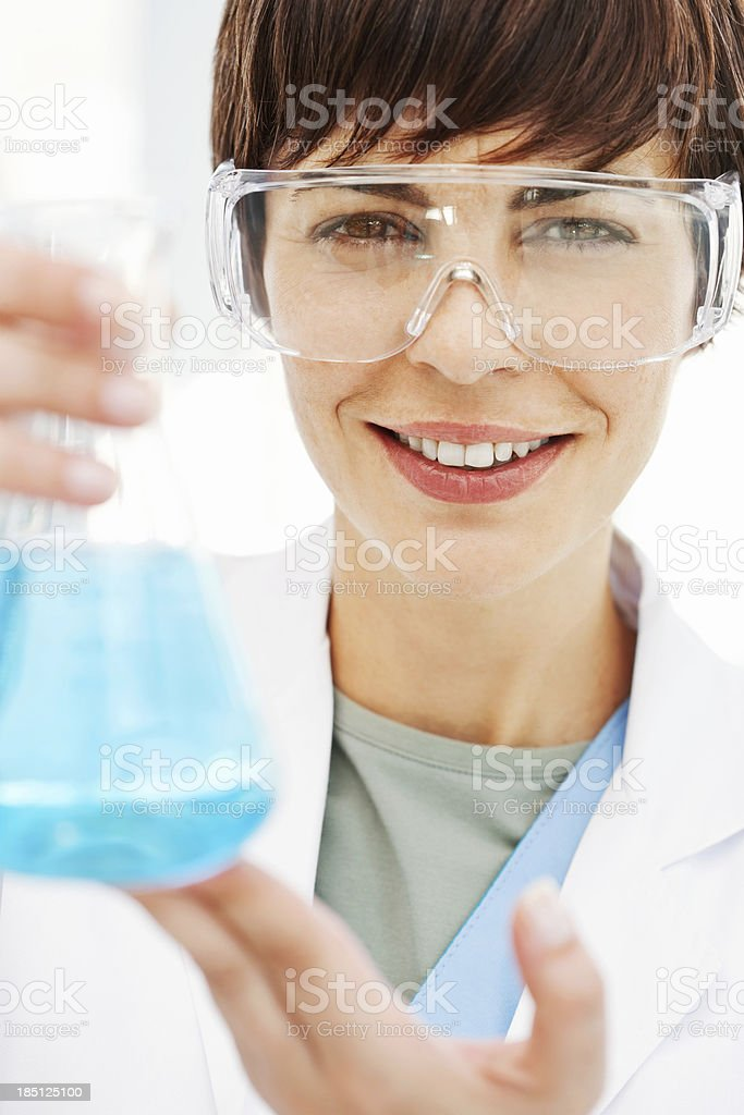 Female Scientist Holding Conical Flask royalty-free stock photo