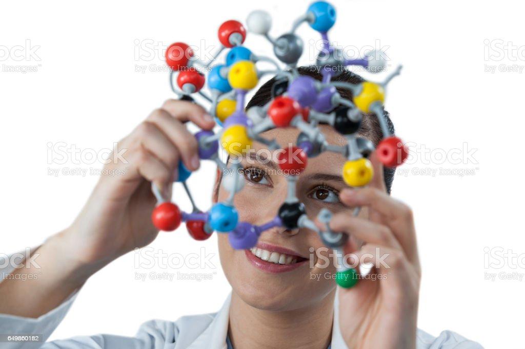 Female scientist holding molecular model stock photo