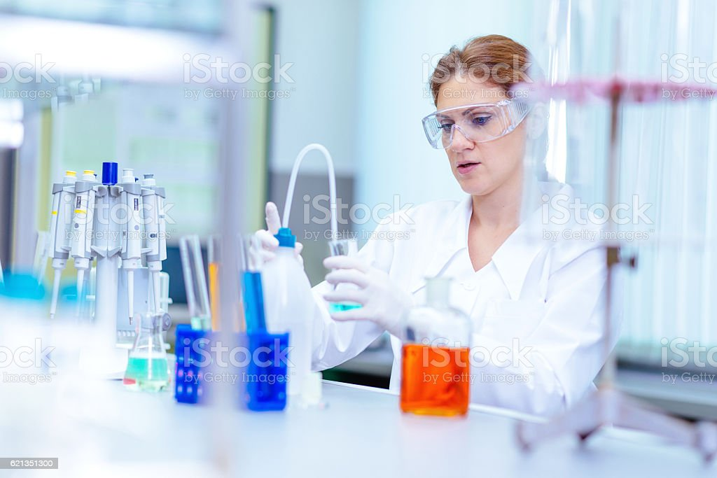 Female scientist in forensic laboratory stock photo