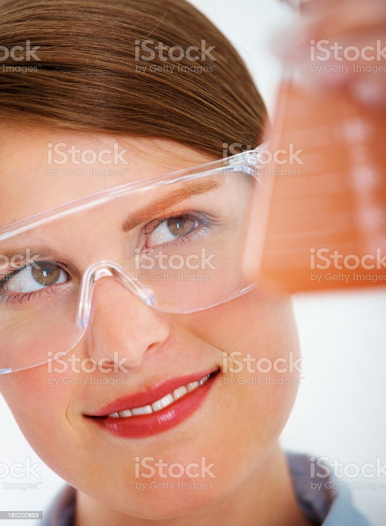 Female scientist looking at the conical flask royalty-free stock photo