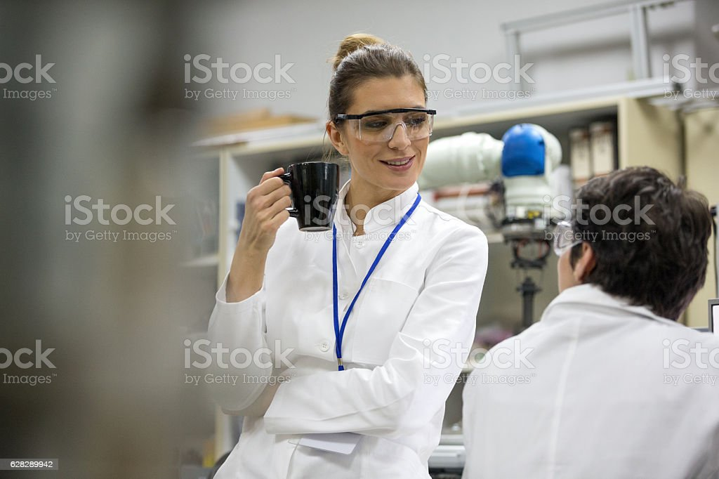 Female scientist on coffee break stock photo