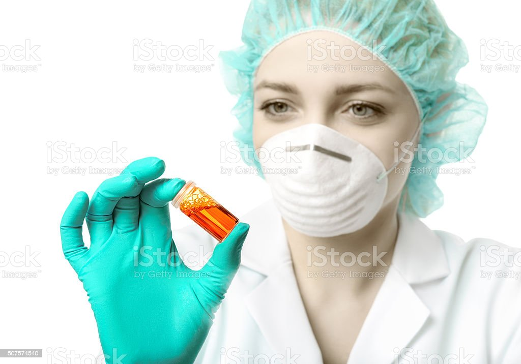 Female scientist or tech holds liquid biological sample stock photo