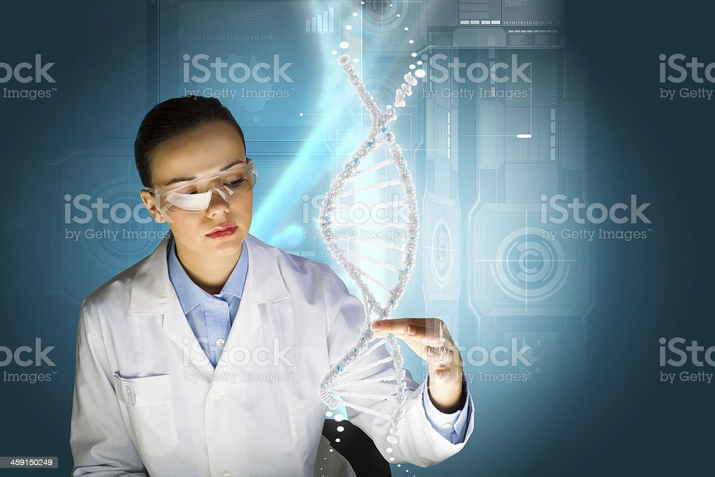 Female scientist physically assessing a DNA molecule stock photo
