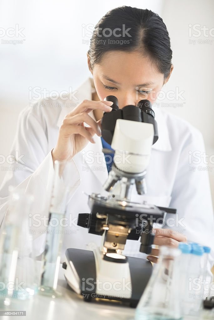 Female Scientist Using Microscope royalty-free stock photo