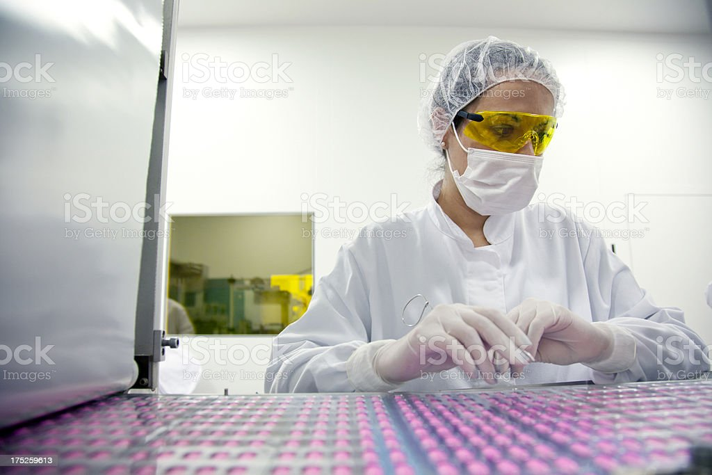 Female scientist working in a factory stock photo