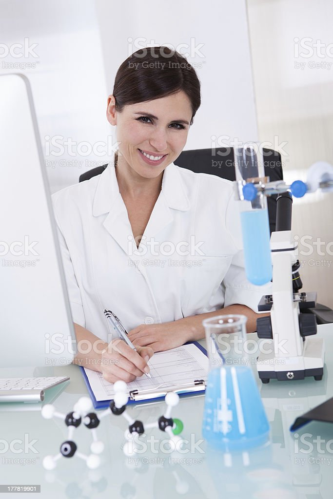 Female Scientist Writing On Paper royalty-free stock photo