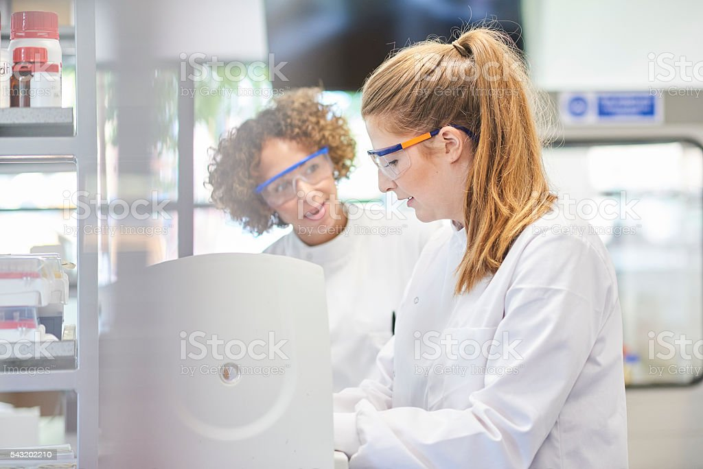 female scientists with centrifuge stock photo