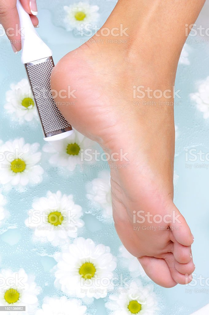 female scrub and clean the well-groomed foot royalty-free stock photo