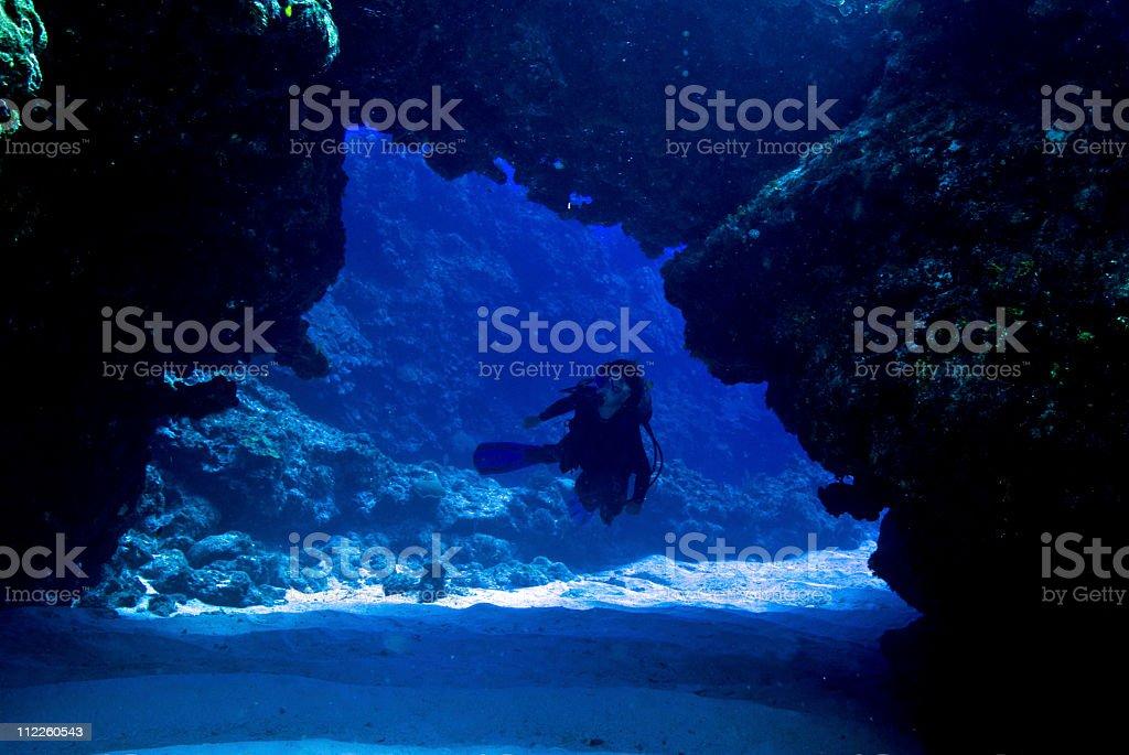 Female scuba diver cave stock photo