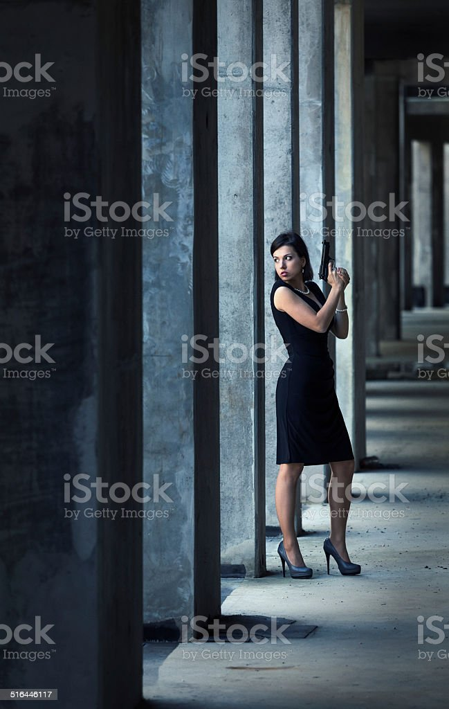 female secret agent in action stock photo