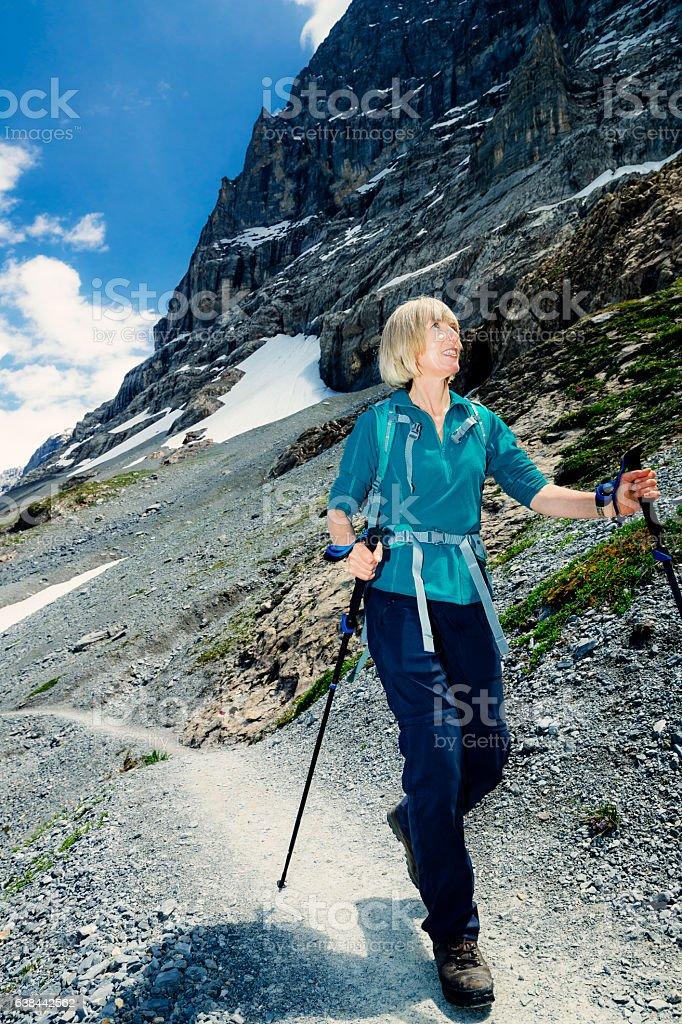 Female senior adult hiker on Eiger Trail, Switzerland stock photo