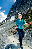 Female senior adult hiker on Eiger Trail, Switzerland