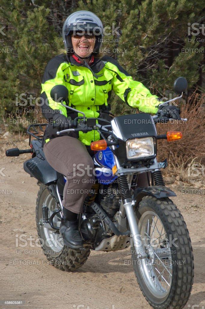 Female Senior Citizen Riding Motorcycle royalty-free stock photo