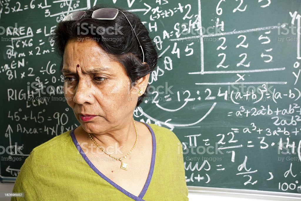 Female Senior Indian Mathematics Teacher Interacting with class royalty-free stock photo