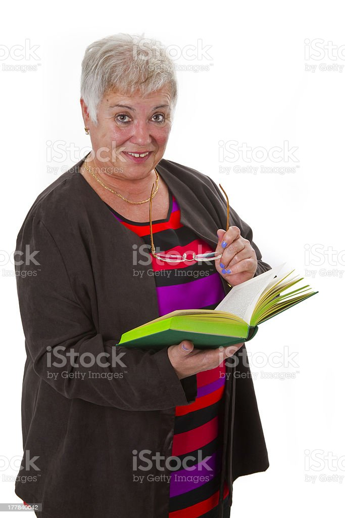 Female senior reading a book royalty-free stock photo