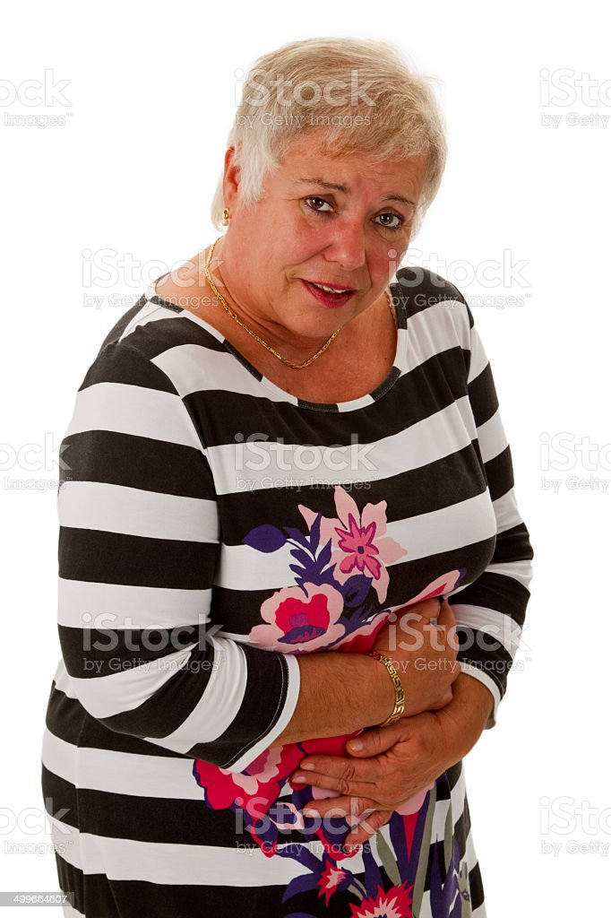 Female senior with stomach pain stock photo