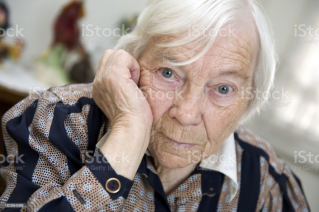 Female Senior woman looks sad stock photo
