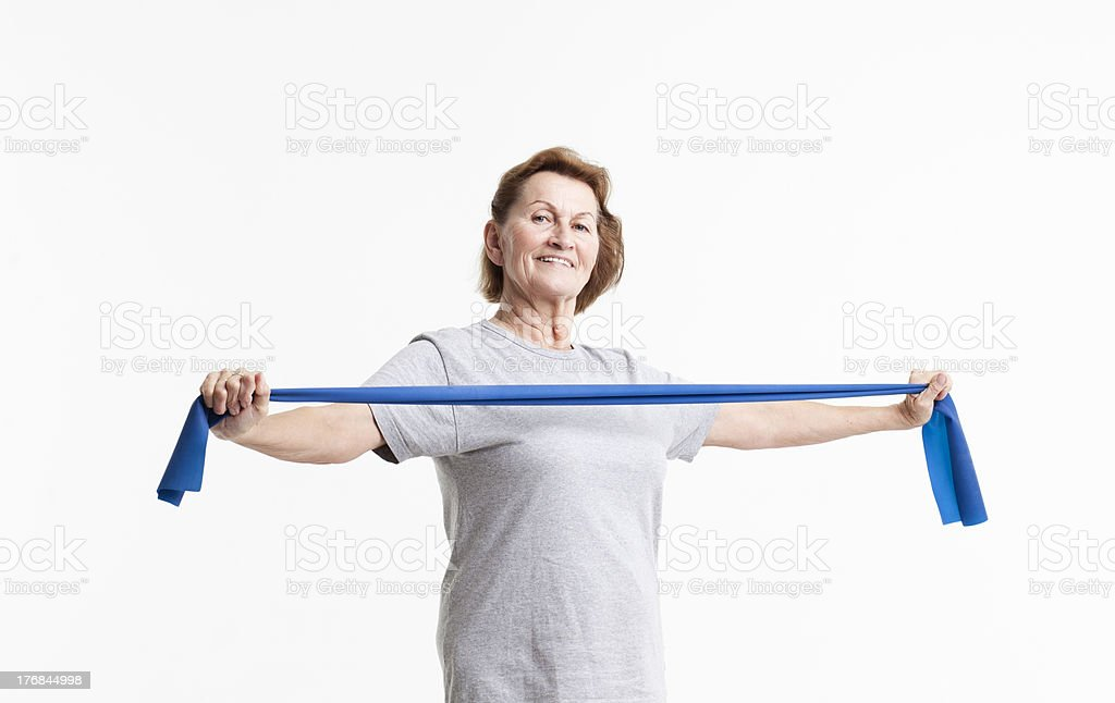 female senior working out stock photo