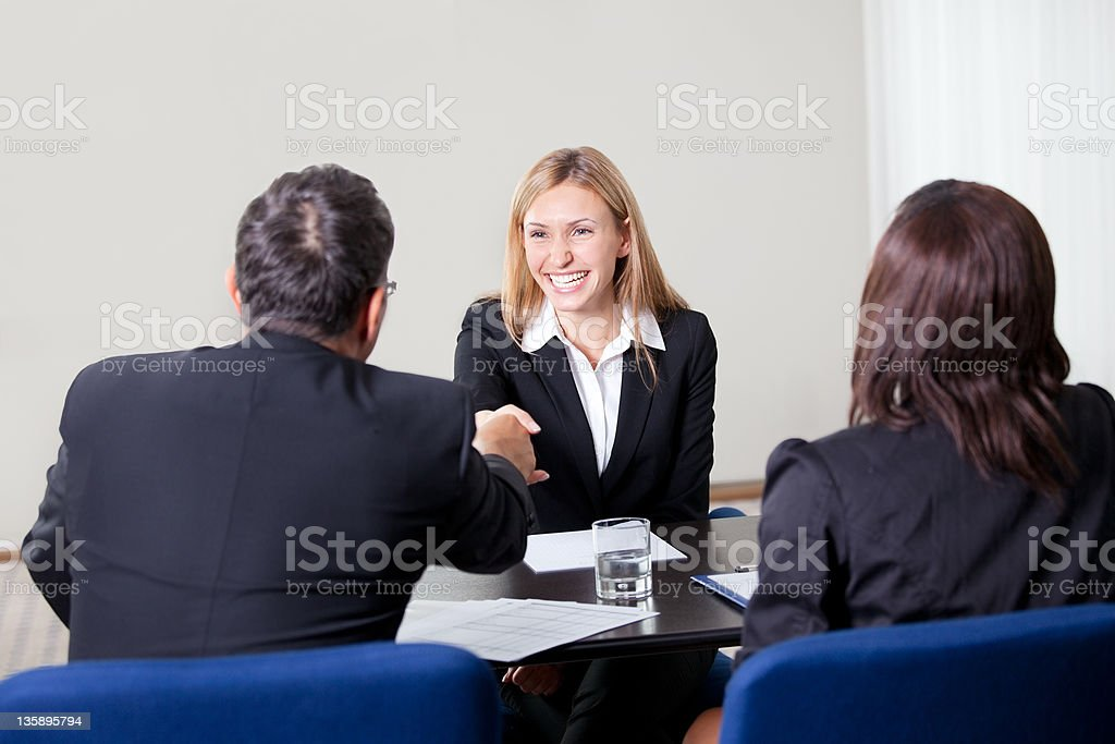 Female shaking hands at the job interview royalty-free stock photo