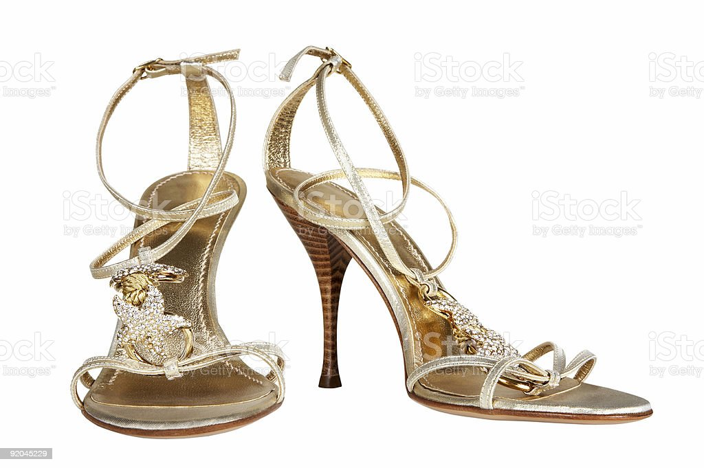 Female shoes of gold color stock photo