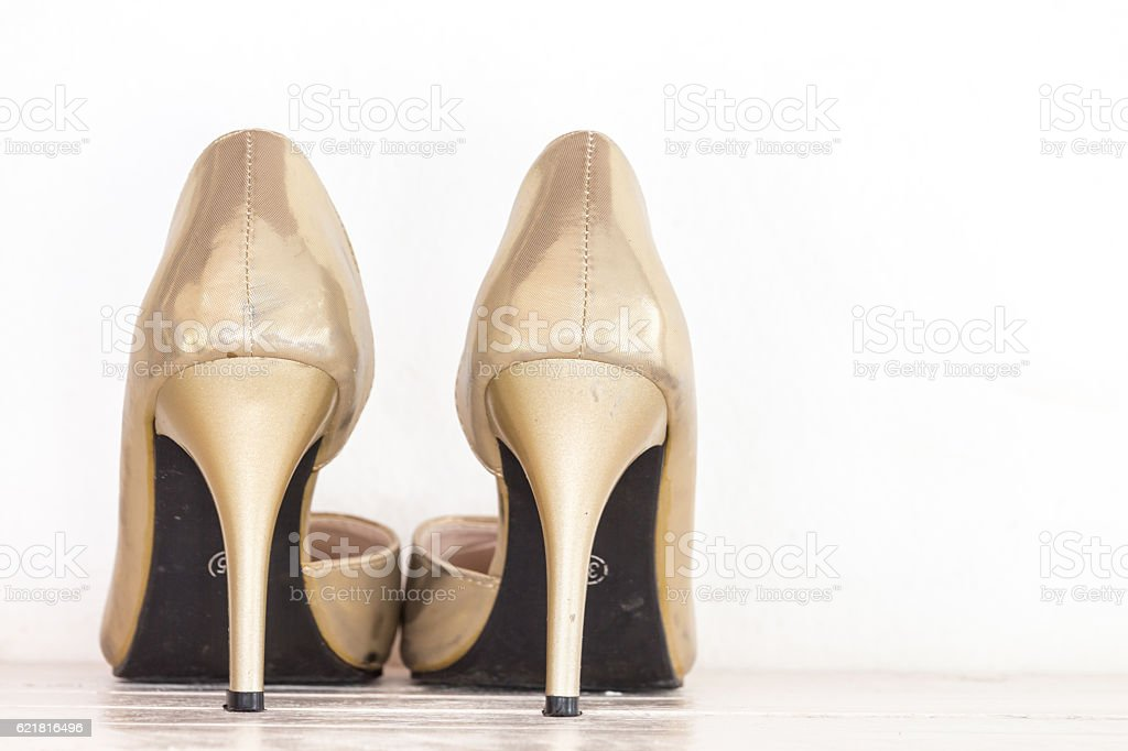 Female shoes on wooden table stock photo