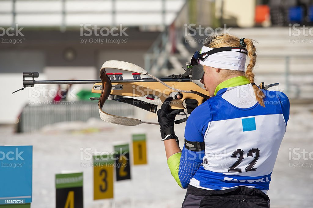 Female shooting at biathlon competition stock photo