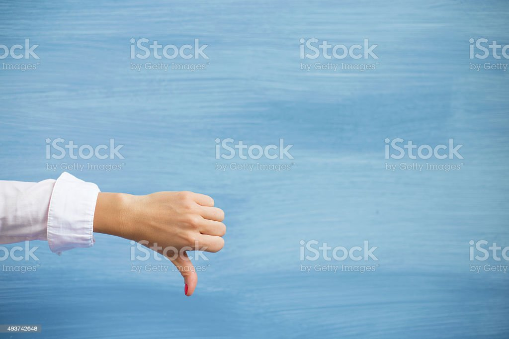 Female showing thumbs down stock photo