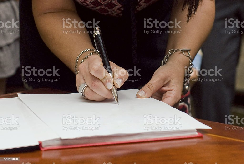 Female signing papers royalty-free stock photo