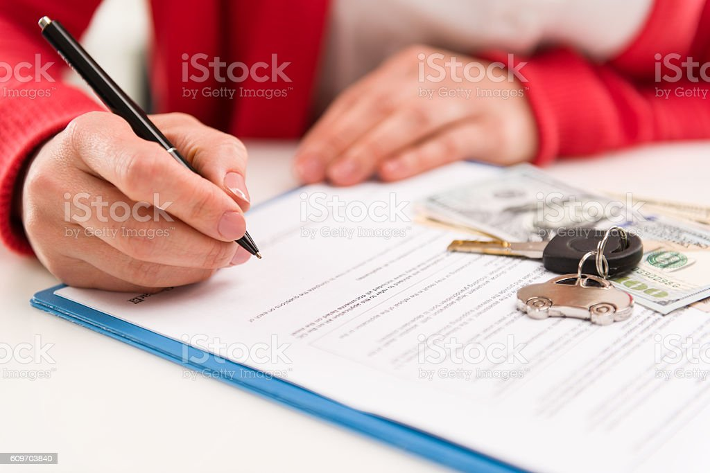 Female signing rent contract stock photo