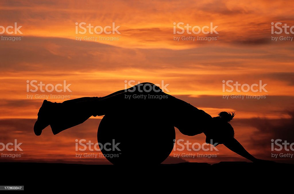 Female silhouette doing pilates royalty-free stock photo