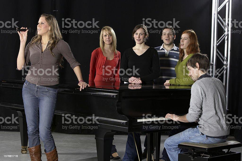 Female singer, Chorus, pianist and grand piano stock photo
