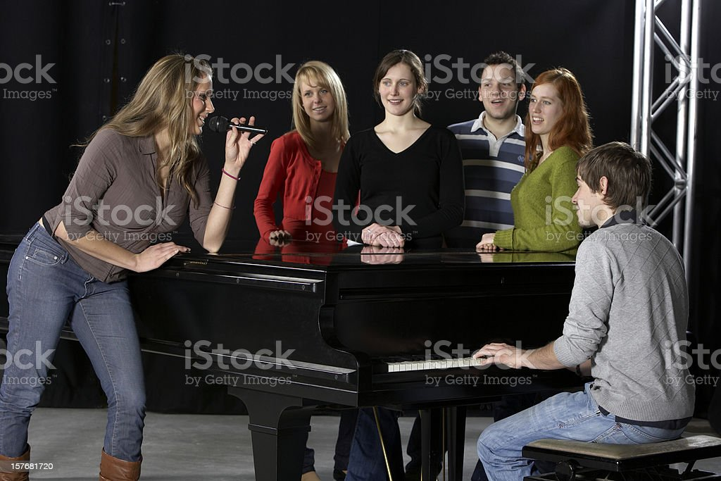 Female singer, Chorus, pianist and grand piano royalty-free stock photo