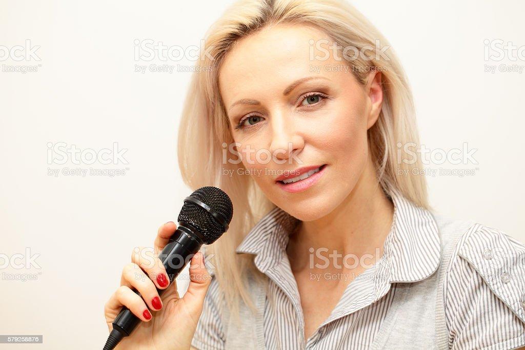 female singer headshot holding microphone stock photo