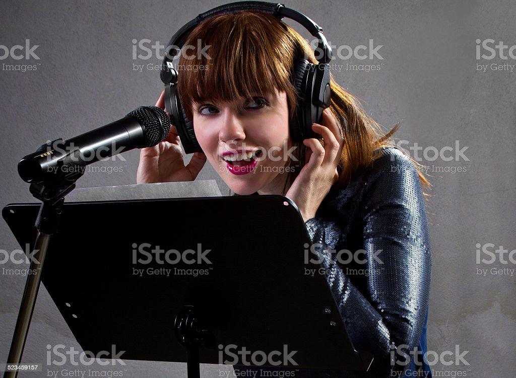 Female Singer on Grey Background stock photo